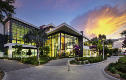 The exterior of a wellness facility pictured at sunset