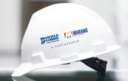 A hard hat featuring the logos of Brasfield & Gorrie and Marand Builders