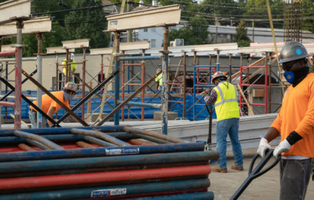 A group of construction workers on an outdoor jobsite