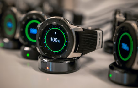 Samsung Galaxy watches charge in preparation for use on a construction jobsite