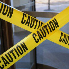 two lines of caution tape barring an area