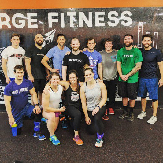 fitness class poses for a group photo
