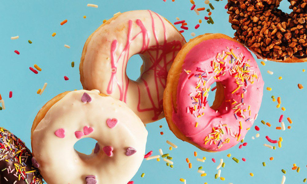 colorful donuts on a bright blue backdrop