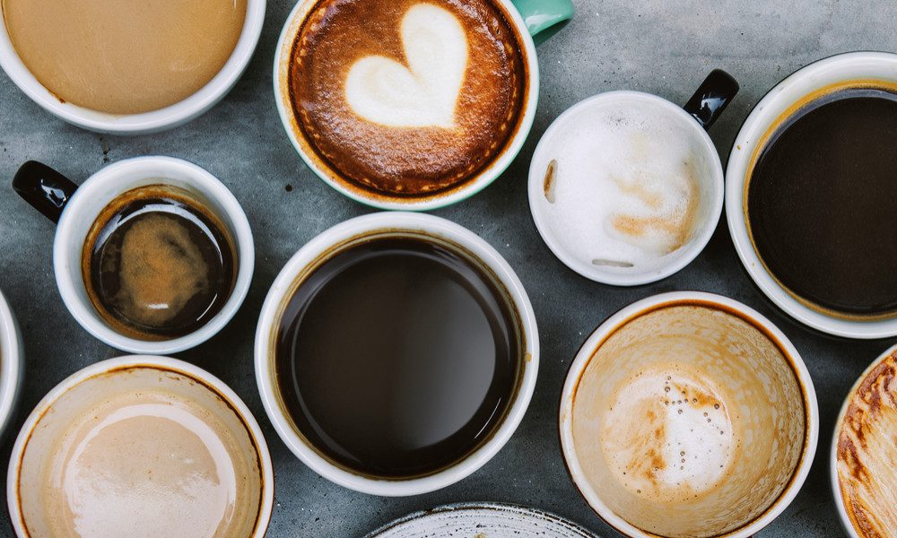 collection of different coffee mugs with various drinks inside