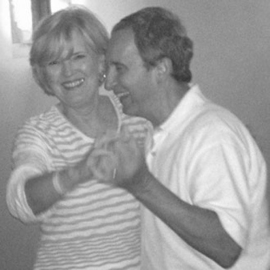 black and white photo of a couple dancing together