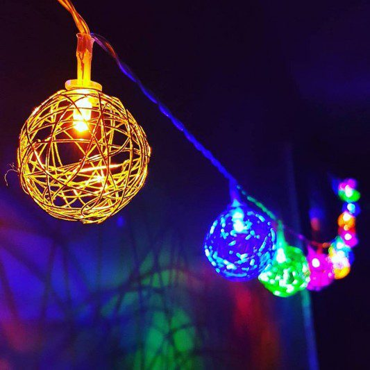 brightly colored string lights lit up at night