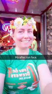 Woman smiles using a Snapchat filter after a run